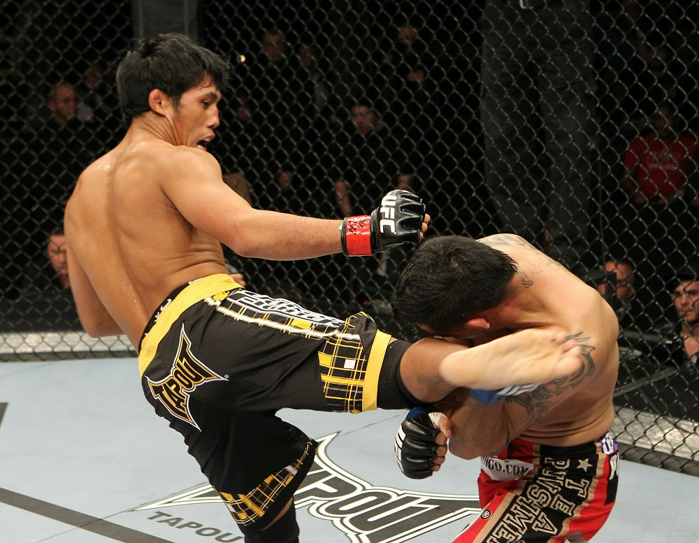 LAS VEGAS - DECEMBER 04: [L-R] Nam Phan hits Leonard Garcia with a kick at The Ultimate Fighter 12 Finale at the Pearl at the Palms on December 4, 2010 in Las Vegas, Nevada. (Photo by Josh Hedges/Zuffa LLC/Zuffa LLC via Getty Images)