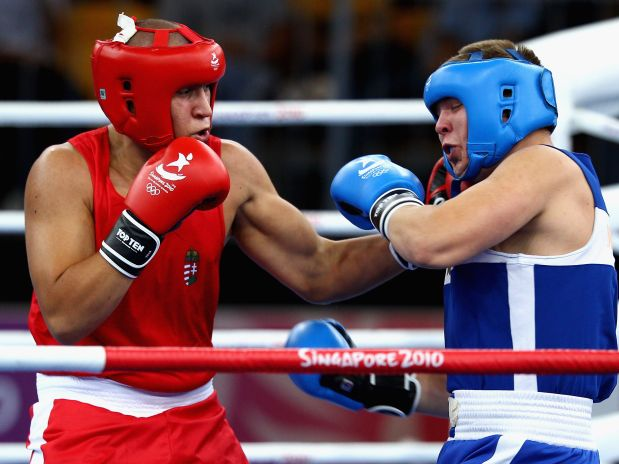 SINGAPORE - AUGUST 24: Jozsef Zsigmond of Hungary competes with Daniil Svaresciuc of Moldova in the Boxing Super Heavy +91kg bronze medal match on day 10 of the Singapore 2010 Youth Olympics at the International Convention Centre on August 24, 2010 in Singapore. (Photo by Mark Dadswell/Getty Images)