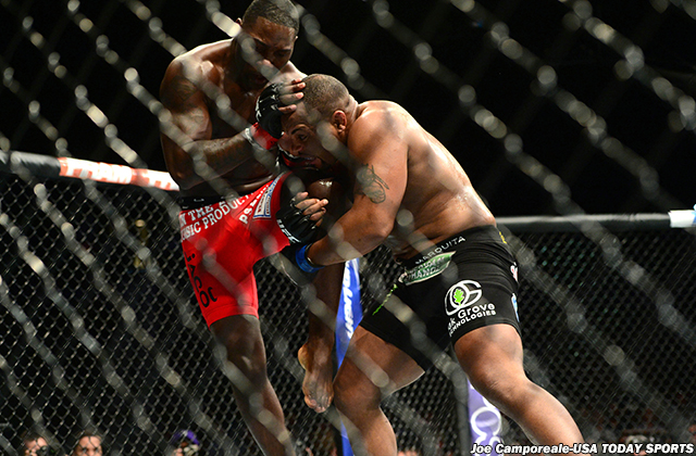May 23, 2015; Las Vegas, NV, USA; Anthony Johnson (red) and Daniel Cormier (blue) fight during their light heavyweight championship bout during UFC 187 at MGM Grand Garden Arena. Cormier won via third round TKO. Mandatory Credit: Joe Camporeale-USA TODAY Sports