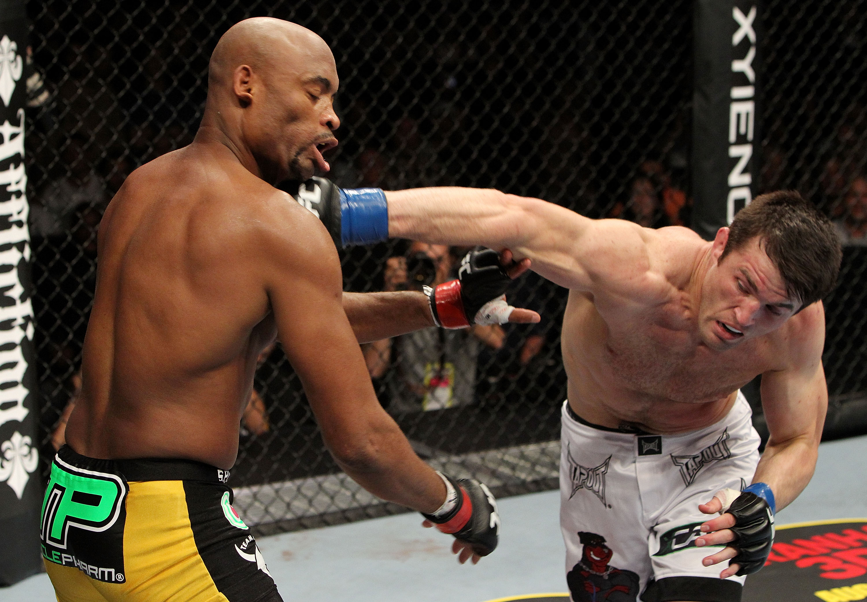 OAKLAND, CA - AUGUST 07:  Chael Sonnen punches Anderson Silva during the UFC Middleweight Championship bout at Oracle Arena on August 7, 2010 in Oakland, California.  (Photo by Josh Hedges/Zuffa LLC/Zuffa LLC via Getty Images)