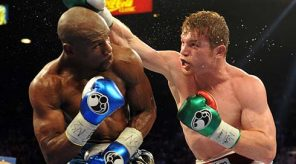 Sep 14, 2013; Las Vegas, NV, USA; Floyd Mayweather Jr. (blue gloves) and Canelo Alvarez battle it during their during their WBC and WBA super welterweight titles fight at MGM Grand Garden Arena. Mandatory Credit: Jayne Kamin-Oncea-USA TODAY Sports