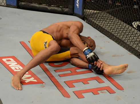 LAS VEGAS, NV - DECEMBER 28: Anderson Silva holds his leg in pain during the UFC middleweight championship bout during the UFC 168 event at the MGM Grand Garden Arena on December 28, 2013 in Las Vegas, Nevada. (Photo by Donald Miralle/Zuffa LLC/Zuffa LLC via Getty Images)
